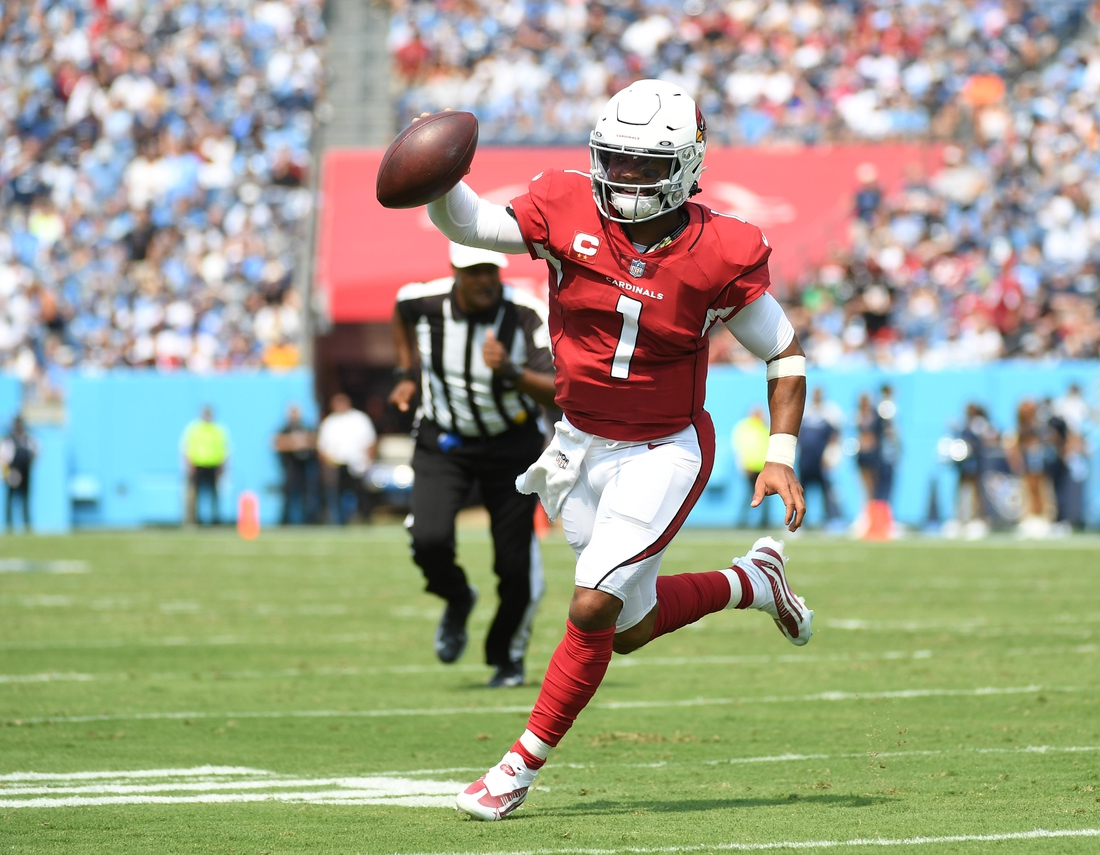 Sep 12, 2021; Nashville, Tennessee, USA; Arizona Cardinals quarterback Kyler Murray (1) runs for a touchdown against the Tennessee Titans at Nissan Stadium. Mandatory Credit: Christopher Hanewinckel-USA TODAY Sports