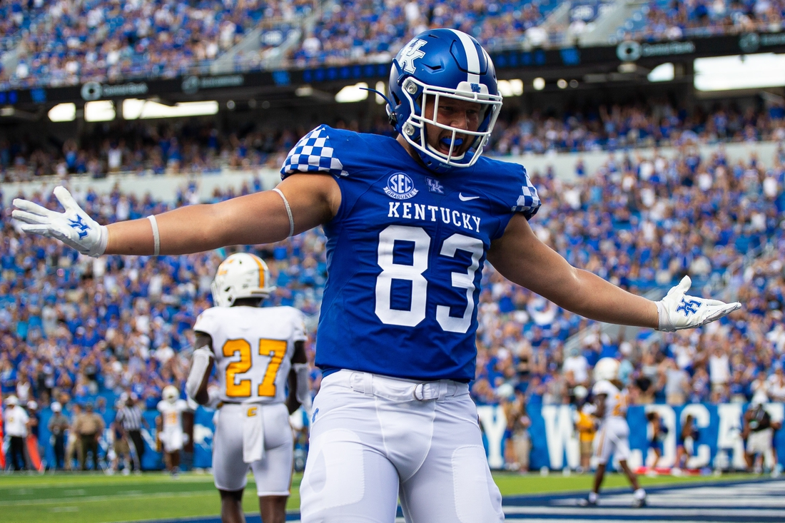 Sep 18, 2021; Lexington, Kentucky, USA; Kentucky Wildcats tight end Justin Rigg (83) celebrates a touchdown by wide receiver Izayah Cummings during the fourth quarter against the Chattanooga Mocs at Kroger Field. Mandatory Credit: Jordan Prather-USA TODAY Sports