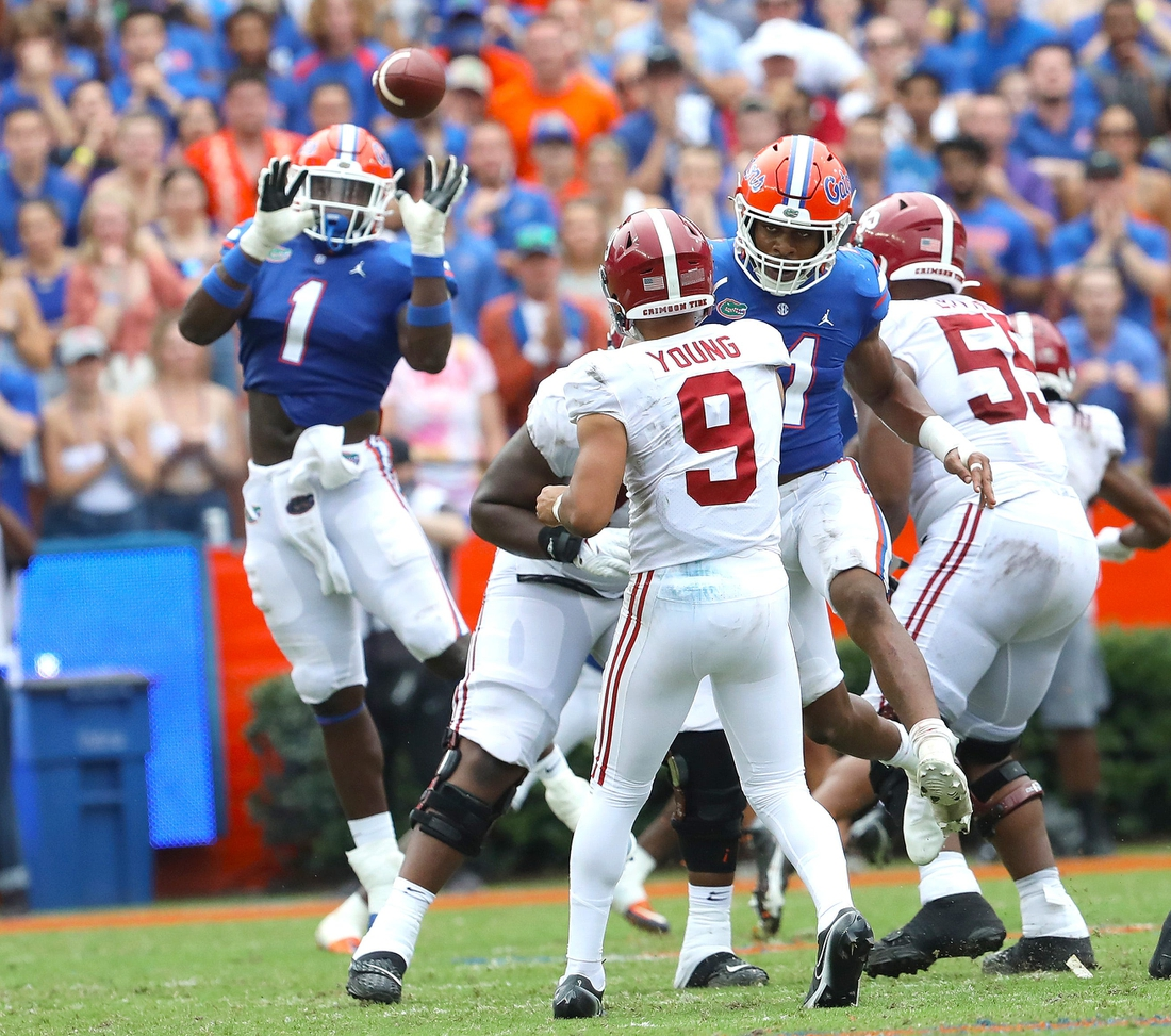 Florida Gators linebacker Brenton Cox Jr. (1) rises up to try for an interception but dropped it during the football game between the Florida Gators and The Alabama Crimson Tide, at Ben Hill Griffin Stadium in Gainesville, Fla. Sept. 18, 2021.  Flgai 09182021 Ufvs Bama 29