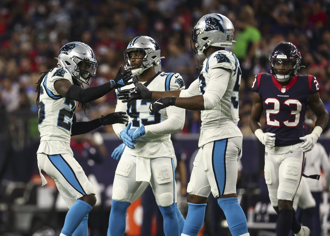 Sep 23, 2021; Houston, Texas, USA; Carolina Panthers defensive end Brian Burns (53) celebrates with cornerback Donte Jackson (26) after a play during the third quarter against the Houston Texans at NRG Stadium. Mandatory Credit: Troy Taormina-USA TODAY Sports
