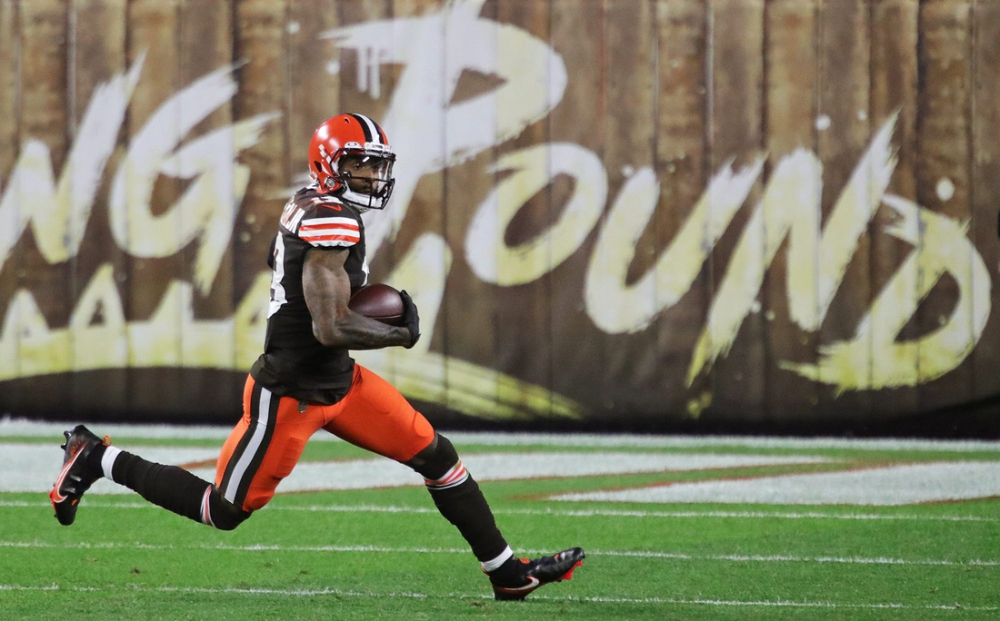 Cleveland Browns wide receiver Odell Beckham Jr. (13) rushes for yards after a reception during the first half of an NFL football game at FirstEnergy Stadium, Thursday, Sept. 17, 2020, in Cleveland, Ohio. [Jeff Lange/Beacon Journal]  Browns 17