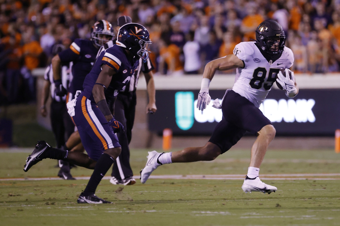 Sep 24, 2021; Charlottesville, Virginia, USA; Wake Forest Demon Deacons tight end Blake Whiteheart (85) runs with the ball as Virginia Cavaliers defensive back Anthony Johnson (3) chases during the second quarter at Scott Stadium. Mandatory Credit: Geoff Burke-USA TODAY Sports