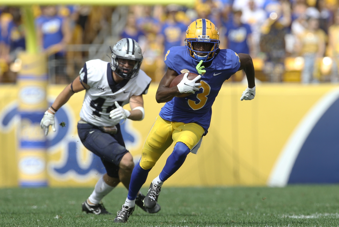 Sep 25, 2021; Pittsburgh, Pennsylvania, USA;  Pittsburgh Panthers wide receiver Jordan Addison (3) runs after a catch on his way to scoring a touchdown as New Hampshire Wildcats defensive back Noah Palm (44) chases during the second quarter at Heinz Field. Mandatory Credit: Charles LeClaire-USA TODAY Sports