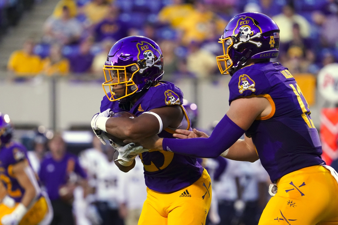 Sep 25, 2021; Greenville, North Carolina, USA; East Carolina Pirates running back Keaton Mitchell (25) scores a first-half touchdown against the Charleston Southern Buccaneers at Dowdy-Ficklen Stadium. Mandatory Credit: James Guillory-USA TODAY Sports