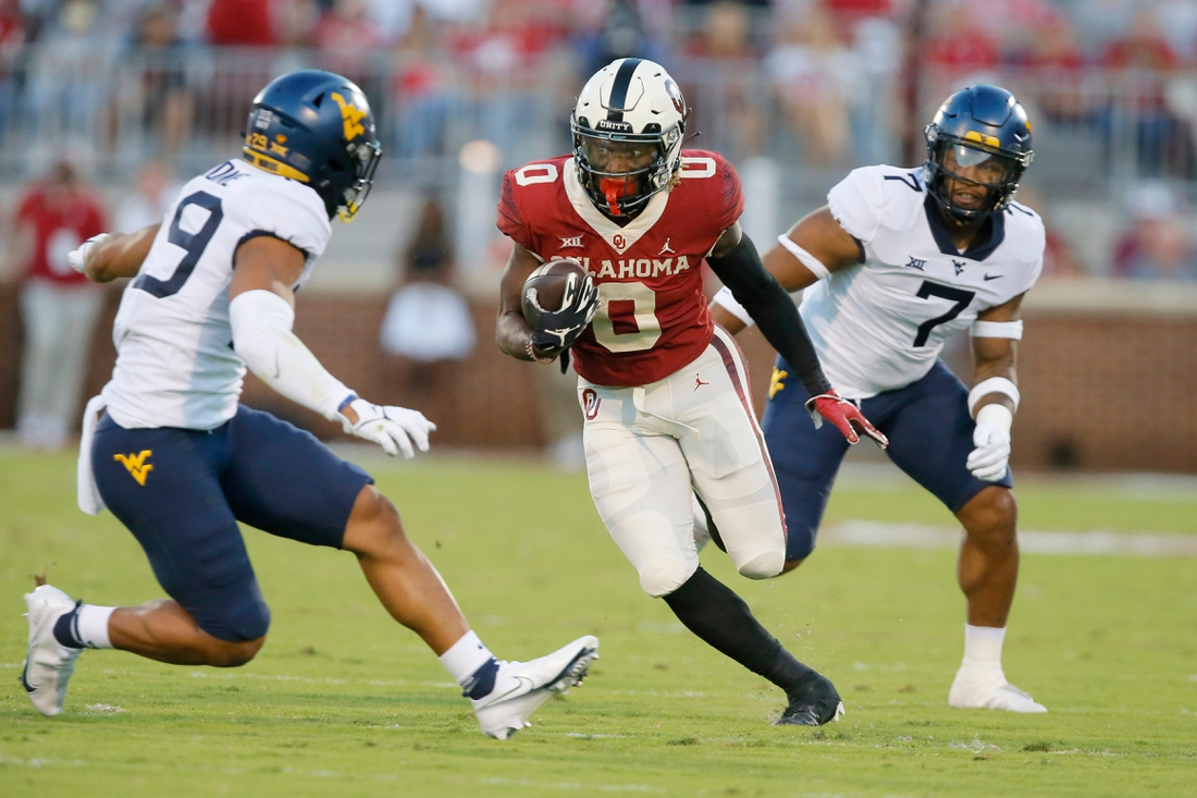 Oklahoma's Eric Gray (0) runs after  reception during a college football game between the University of Oklahoma Sooners (OU) and the West Virginia Mountaineers at Gaylord Family-Oklahoma Memorial Stadium in Norman, Okla., Saturday, Sept. 25, 2021.  Lx10761