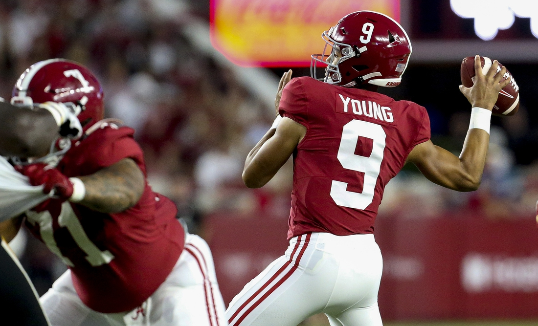 Sep 25, 2021; Tuscaloosa, Alabama, USA;  Alabama Crimson Tide quarterback Bryce Young (9) throws a pass for a touchdown against the Southern Miss Golden Eagles during the first half at Bryant-Denny Stadium. Mandatory Credit: Gary Cosby-USA TODAY Sports