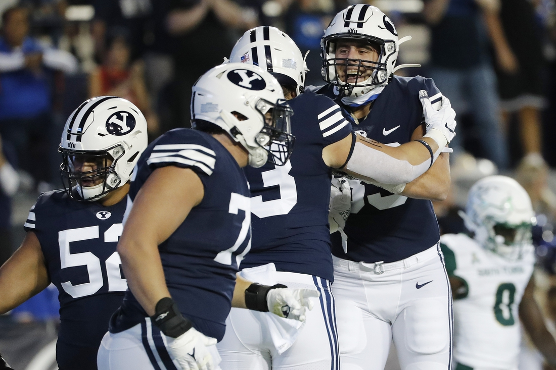 Sep 25, 2021; Provo, Utah, USA;  Brigham Young Cougars fullback Masen Wake (13) celebrates his touchdown with tight end Isaac Rex (83) in the first quarter against the South Florida Bulls at LaVell Edwards Stadium. Mandatory Credit: Jeffrey Swinger-USA TODAY Sports