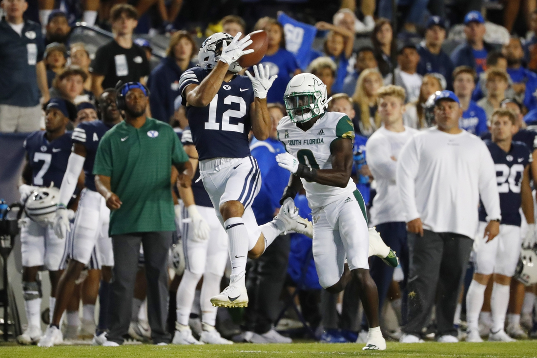 Sep 25, 2021; Provo, Utah, USA; Brigham Young Cougars wide receiver Puka Nacua (12) makes a reception for a first down past DUPLICATE***South Florida Bulls defensive back Daquan Evans (0)***South Florida Bulls running back Jaren Mangham (0) in the first quarter at LaVell Edwards Stadium. Mandatory Credit: Jeffrey Swinger-USA TODAY Sports