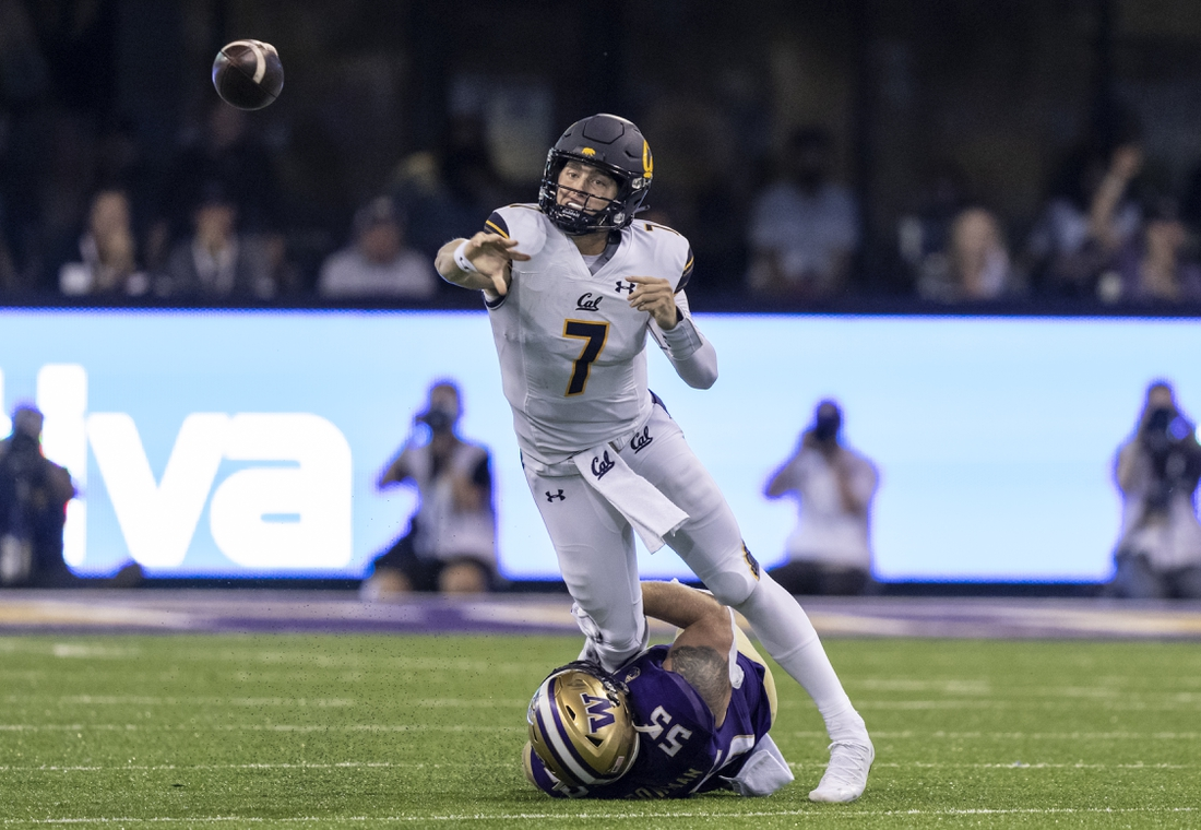 Sep 25, 2021; Seattle, Washington, USA;  California Golden Bears quarterback Chase Garbers (7) throws a passes before getting sacked by Washington Huskies linebacker Ryan Bowman (55) during the first half of a game at Alaska Airlines Field at Husky Stadium. Mandatory Credit: Stephen Brashear-USA TODAY Sports