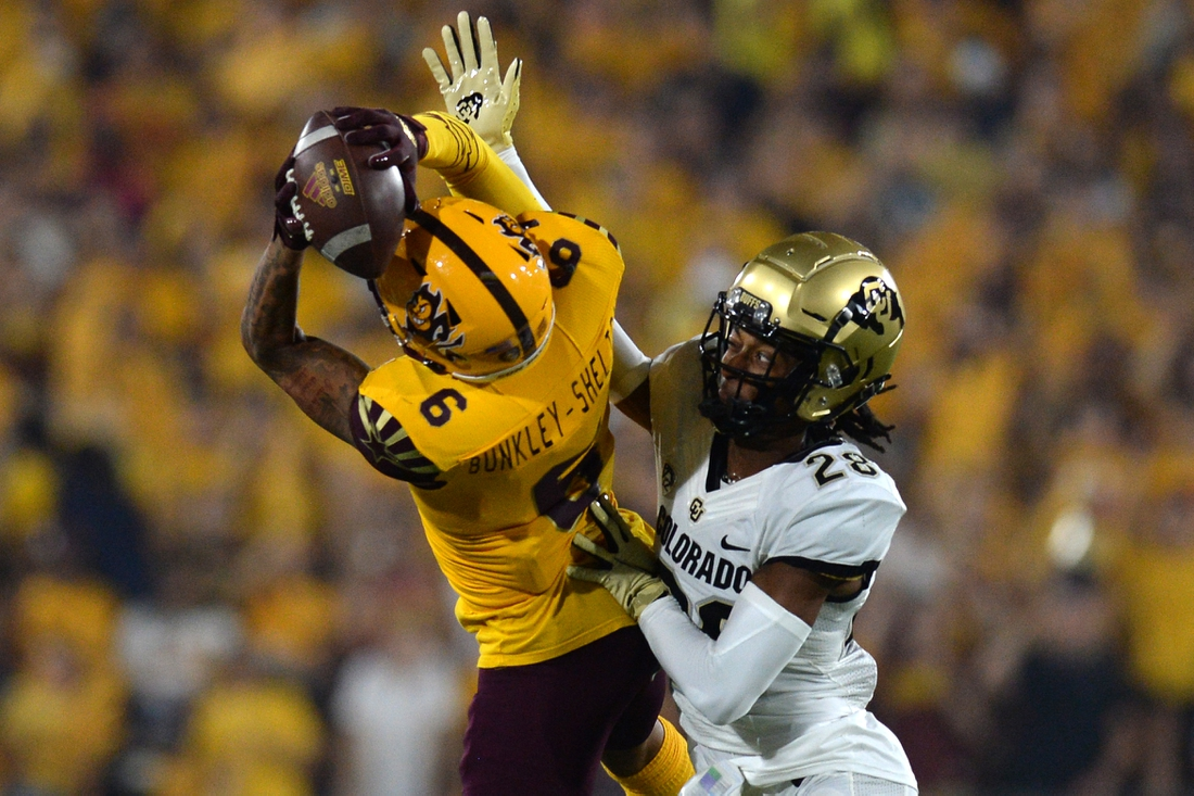 Sep 25, 2021; Tempe, Arizona, USA; Colorado Buffaloes cornerback Tyrin Taylor (28) breaks up a pass intended for Arizona State Sun Devils wide receiver LV Bunkley-Shelton (6) during the first half at Sun Devil Stadium. Mandatory Credit: Joe Camporeale-USA TODAY Sports