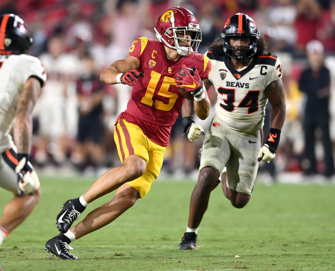 Sep 25, 2021; Los Angeles, California, USA; USC Trojans wide receiver Drake London (15) runs the ball after a complete pass in the second half of the game at United Airlines Field at Los Angeles Memorial Coliseum. Mandatory Credit: Jayne Kamin-Oncea-USA TODAY Sports