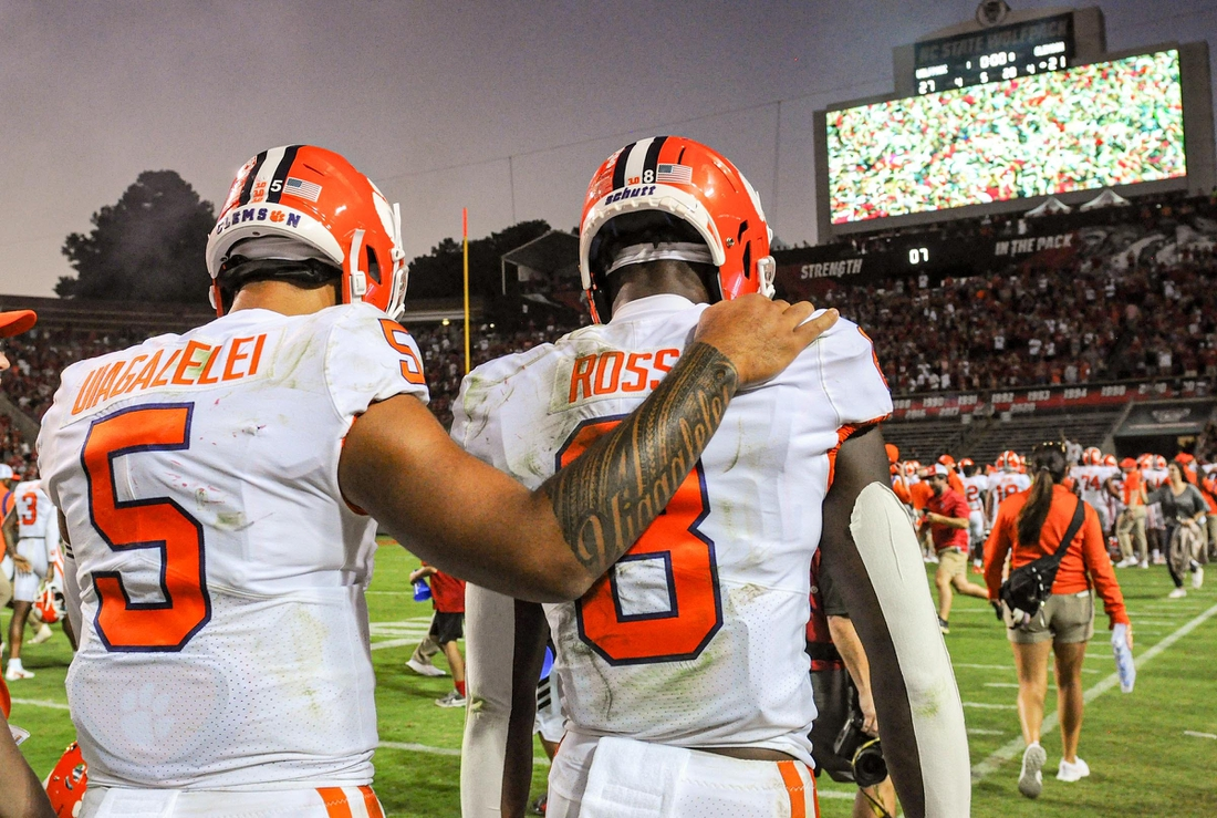Clemson wide receiver Justyn Ross (8) is consoled by quarterback D.J. Uiagalelei (5) after the Tigers lost 27-21 in two overtimes on Saturday in Raleigh, N.C.  Ncaa Football Clemson At Nc State