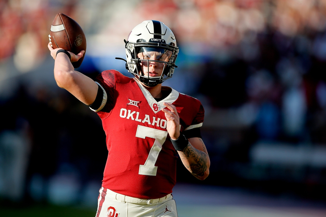 Oklahoma's Spencer Rattler (7) warms up before a college football game between the University of Oklahoma Sooners (OU) and the West Virginia Mountaineers at Gaylord Family-Oklahoma Memorial Stadium in Norman, Okla., Saturday, Sept. 25, 2021. Oklahoma won 16-13.  Lx10117