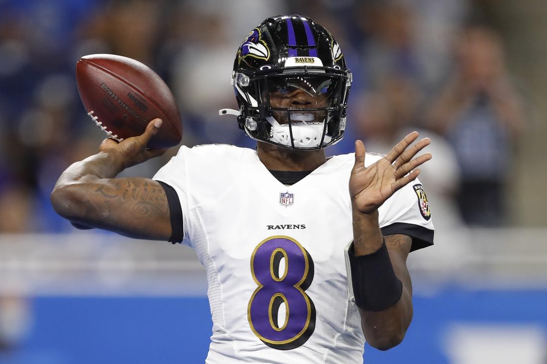 Sep 26, 2021; Detroit, Michigan, USA; Baltimore Ravens quarterback Lamar Jackson (8) passes the ball during the first quarter against the Detroit Lions at Ford Field. Mandatory Credit: Raj Mehta-USA TODAY Sports