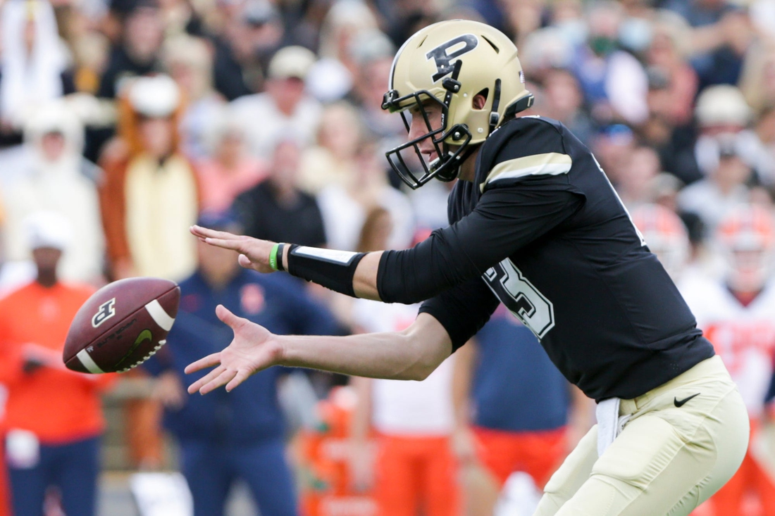 Purdue quarterback Jack Plummer (13) catches the snap during the first quarter of an NCAA college football game, Saturday, Sept. 25, 2021 at Ross-Ade Stadium in West Lafayette.  Cfb Purdue Vs Illinois