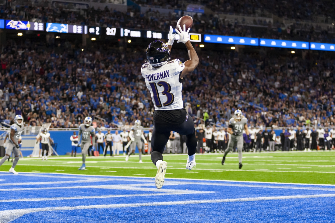 Sep 26, 2021; Detroit, Michigan, USA; Baltimore Ravens wide receiver Devin Duvernay (13) makes a touchdown catch during the second quarter against the Detroit Lions at Ford Field. Mandatory Credit: Raj Mehta-USA TODAY Sports