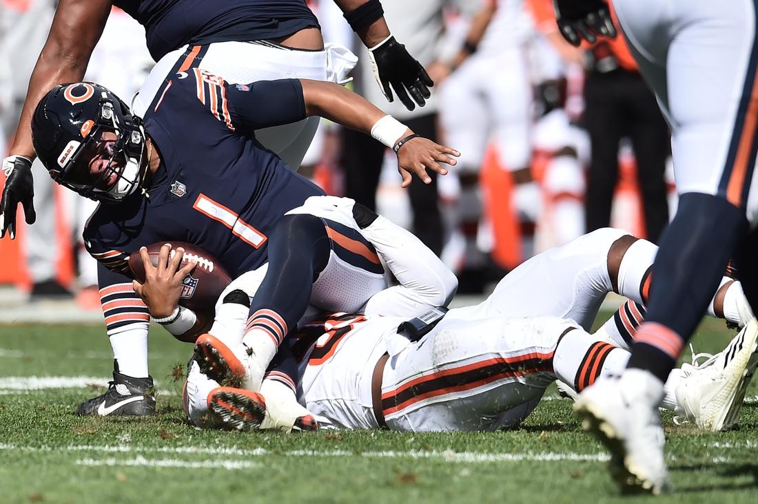 Sep 26, 2021; Cleveland, Ohio, USA; Cleveland Browns defensive end Myles Garrett (95) sacks Chicago Bears quarterback Justin Fields (1) during the first half at FirstEnergy Stadium. Mandatory Credit: Ken Blaze-USA TODAY Sports