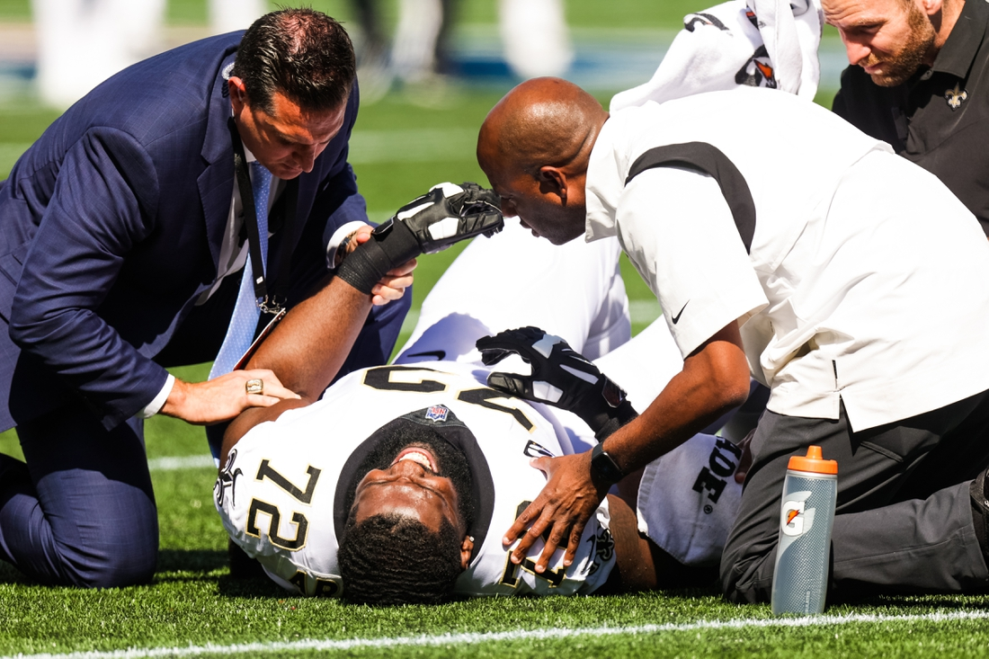Sep 26, 2021; Foxborough, Massachusetts, USA;  New Orleans Saints offensive tackle Terron Armstead (72) is injured on a play against New England Patriots during the first half at Gillette Stadium. Mandatory Credit: Stephen Lew-USA TODAY Sports