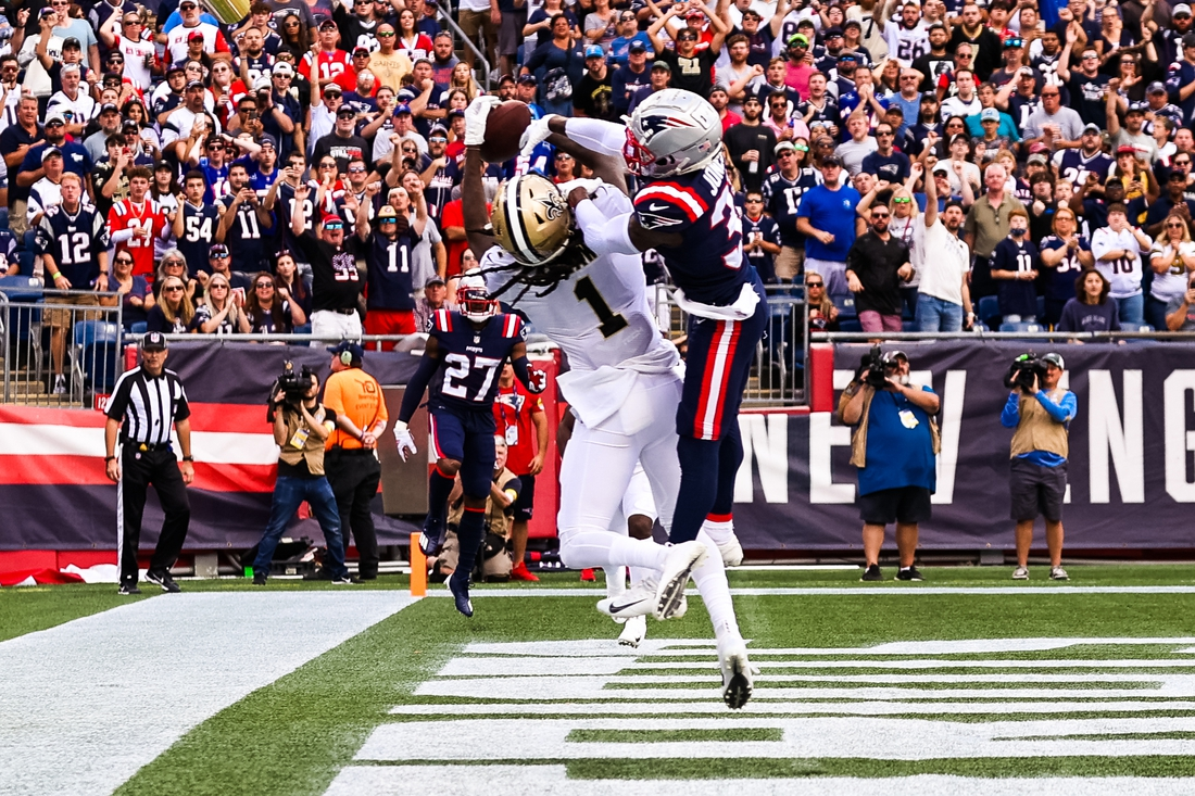 Sep 26, 2021; Foxborough, Massachusetts, USA; New Orleans Saints wide receiver Marquez Callaway (1) catches a touchdown against New England Patriots defensive back Jonathan Jones (31) during the first half at Gillette Stadium. Mandatory Credit: Stephen Lew-USA TODAY Sports