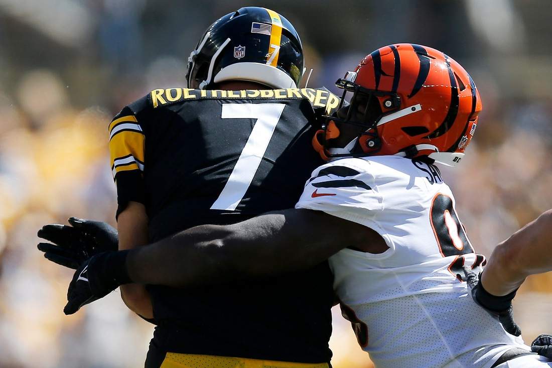 Cincinnati Bengals defensive end Cameron Sample (96) wraps up Pittsburgh Steelers quarterback Ben Roethlisberger (7) in the first quarter of the NFL Week 3 game between the Pittsburgh Steelers and the Cincinnati Bengals at Heinz Field in Pittsburgh on Sunday, Sept. 26, 2021. The Bengals led 14-7 at halftime.  Cincinnati Bengals At Pittsburgh Steelers