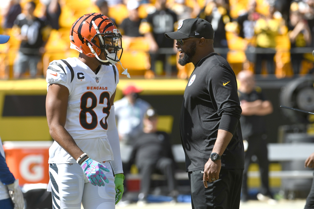 Sep 19, 2021; Pittsburgh, Pennsylvania, USA;  Cincinnati Bengals wide receiver Tyler Boyd (left) meets with Pittsburgh Steelers head coach Mike Tomlin before their game at Heinz Field. Mandatory Credit: Philip G. Pavely-USA TODAY Sports