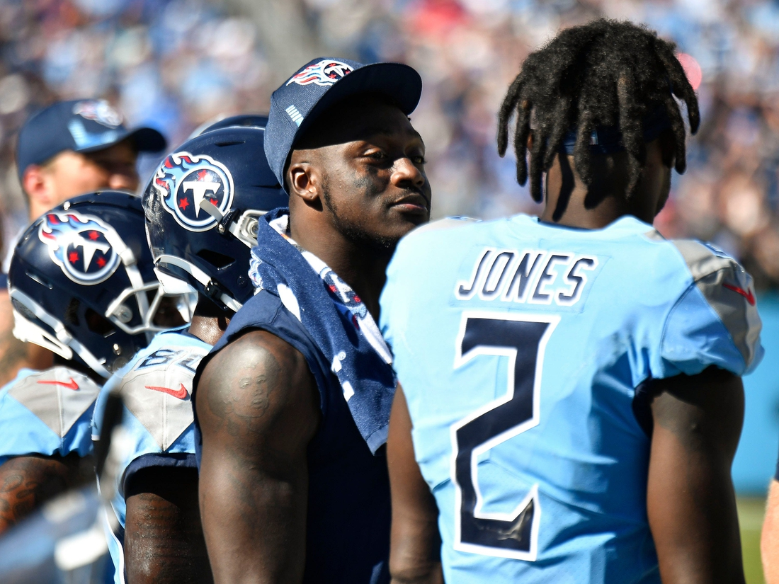 Tennessee Titans wide receiver A.J. Brown (11) and Tennessee Titans wide receiver Julio Jones (2) stand on the sideline after they were each injured during their game against the Colts at Nissan Stadium Sunday, Sept. 26, 2021 in Nashville, Tenn.  Titans Colts 234