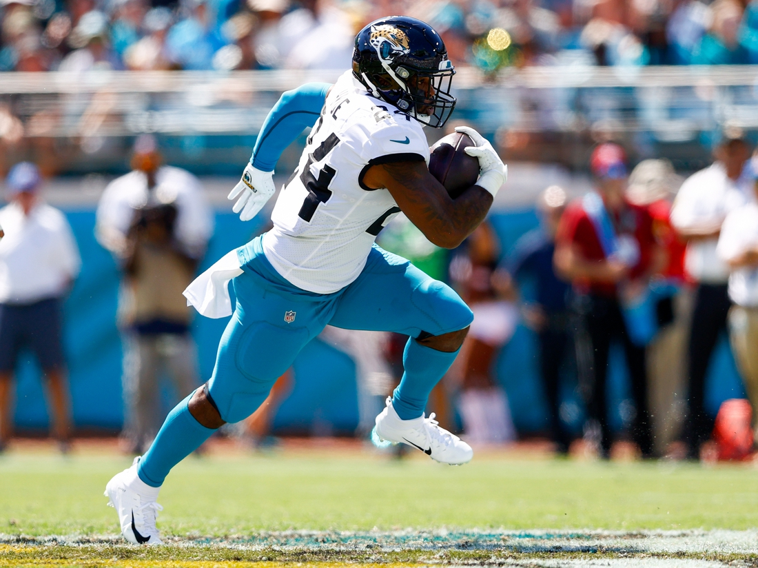 Sep 26, 2021; Jacksonville, Florida, USA; Jacksonville Jaguars running back Carlos Hyde (24) runs with the ball in the second quarter against the Arizona Cardinals at TIAA Bank Field. Mandatory Credit: Nathan Ray Seebeck-USA TODAY Sports