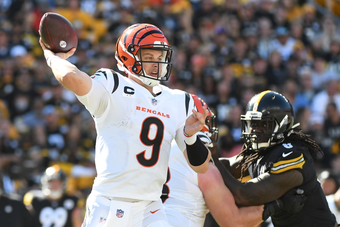 Sep 19, 2021; Pittsburgh, Pennsylvania, USA;  Cincinnati Bengals quarterback Joe Burrow (9) looks for a receiver during the fourth quarter as Pittsburgh Steelers linebacker Melvin Ingram III applies pressure at Heinz Field. The Bengals won 24-10. Mandatory Credit: Philip G. Pavely-USA TODAY Sports
