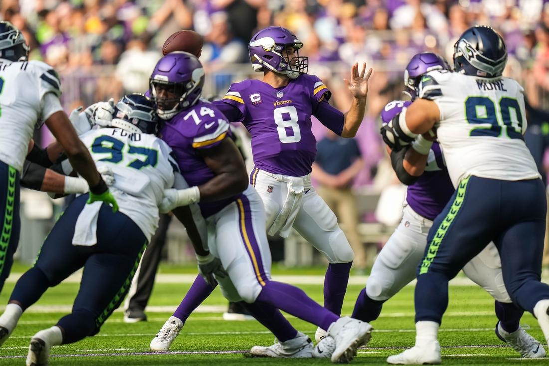 Sep 26, 2021; Minneapolis, Minnesota, USA; Minnesota Vikings quarterback Kirk Cousins (8) throws the ball during the first quarter against Seattle Seahawks at U.S. Bank Stadium. Mandatory Credit: Brace Hemmelgarn-USA TODAY Sports