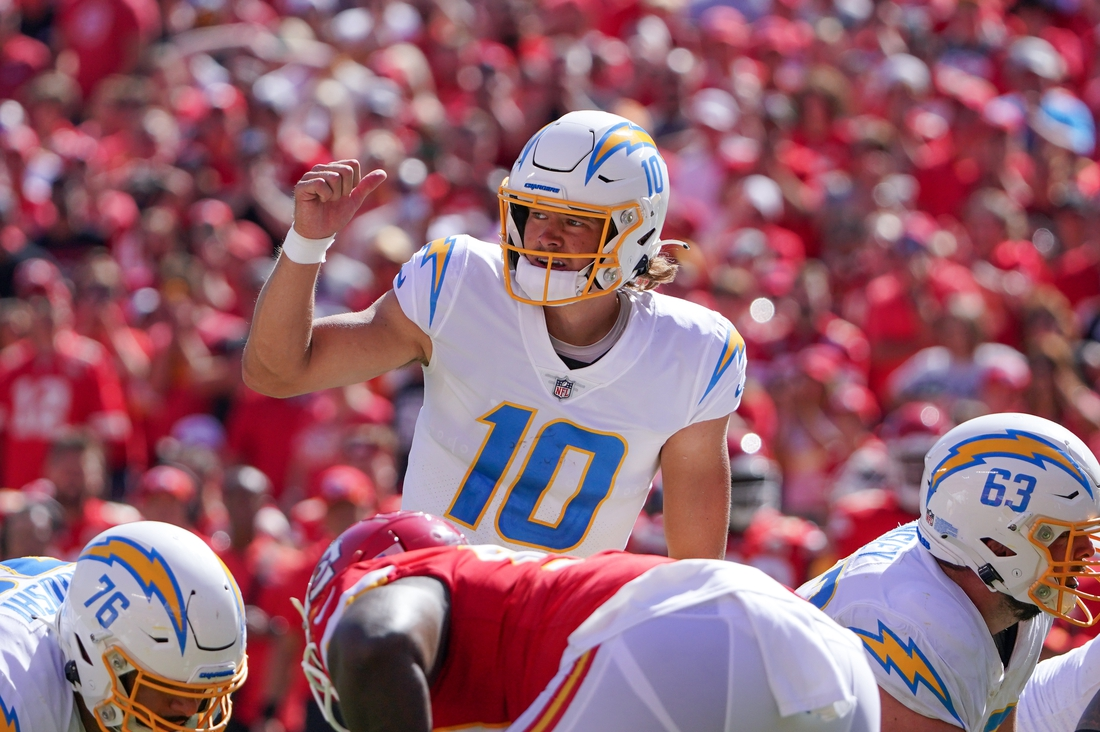 Sep 26, 2021; Kansas City, Missouri, USA; Los Angeles Chargers quarterback Justin Herbert (10) gestures on the line of scrimmage against the Kansas City Chiefs during the second half at GEHA Field at Arrowhead Stadium. Mandatory Credit: Denny Medley-USA TODAY Sports