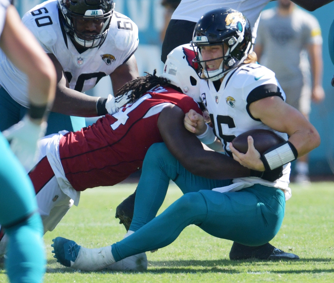 Jacksonville Jaguars quarterback Trevor Lawrence (16) gets brought down by Arizona Cardinals linebacker Markus Golden (44) during fourth quarter action. The Jacksonville Jaguars hosted the Arizona Cardinals at TIAA Bank Field in Jacksonville, FL Sunday, September 26, 2021. The Jaguars went into the half with a 13 to 7 lead but fell to the Cardinals with a final score of 19 to 31. [Bob Self/Florida Times-Union]  Jki 092621 Bsjagsvscardina 6