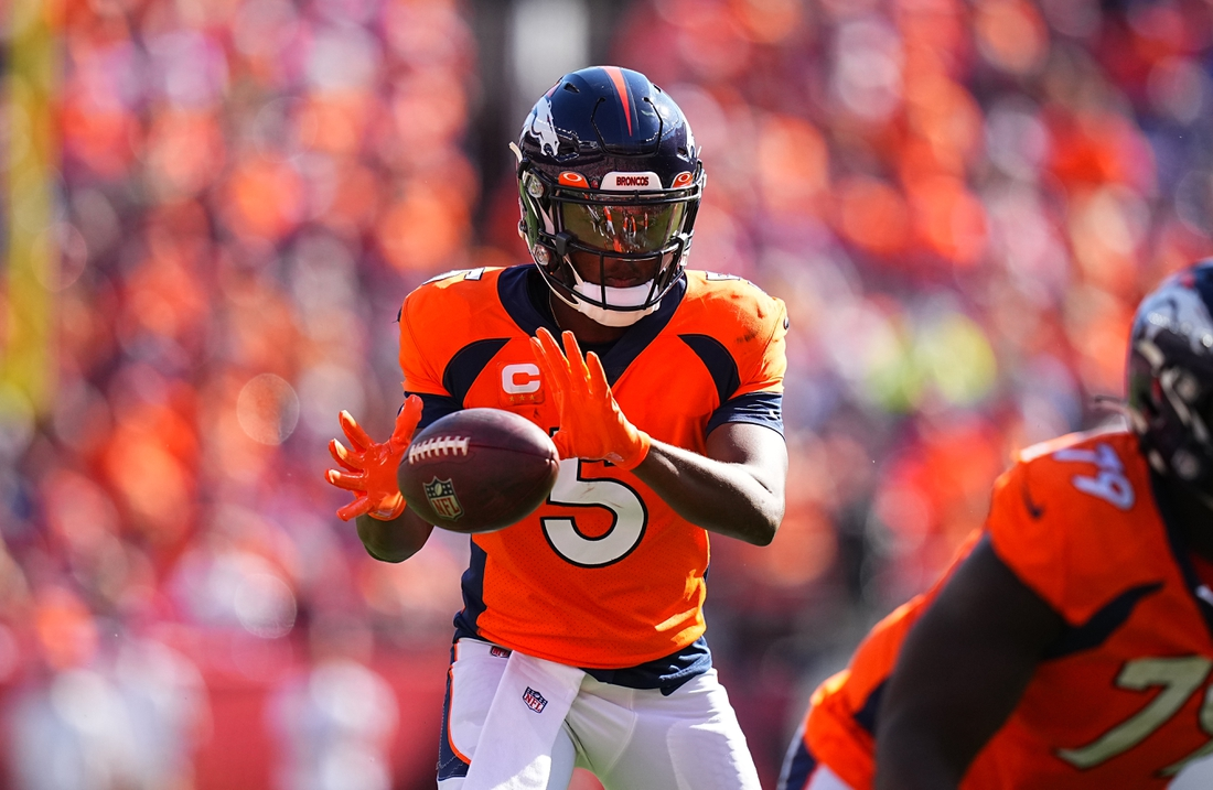 Sep 26, 2021; Denver, Colorado, USA; Denver Broncos quarterback Teddy Bridgewater (5) takes a snap in the second quarter against the New York Jets at Empower Field at Mile High. Mandatory Credit: Ron Chenoy-USA TODAY Sports