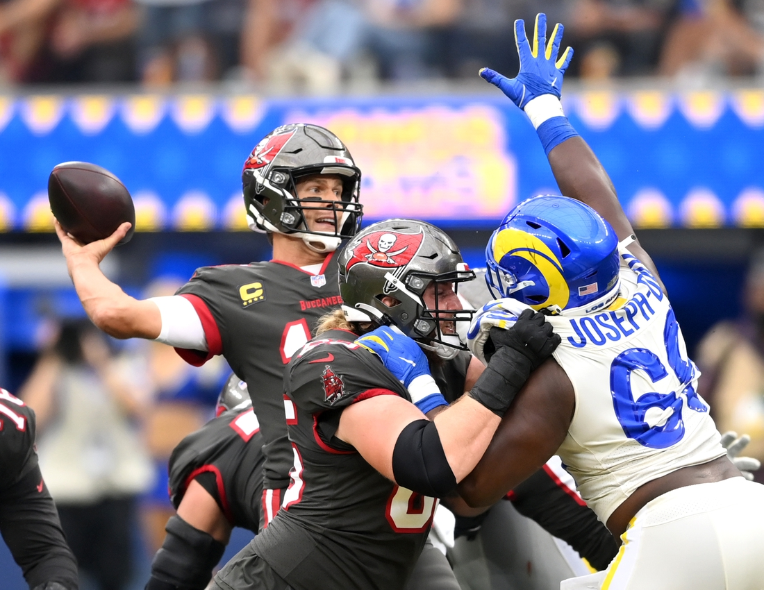 Sep 26, 2021; Inglewood, California, USA;  Los Angeles Rams defensive tackle Sebastian Joseph-Day (69) pressures Tampa Bay Buccaneers quarterback Tom Brady (12) as he looks to throw a pass in the first half of the game at SoFi Stadium. Mandatory Credit: Jayne Kamin-Oncea-USA TODAY Sports
