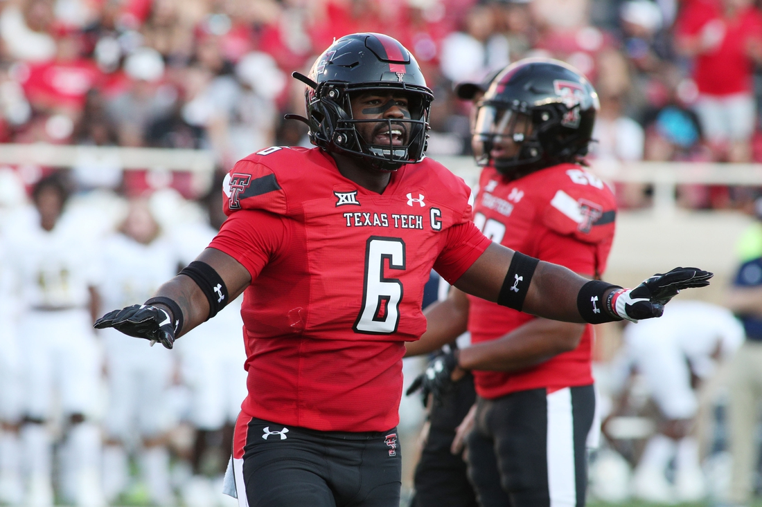 Sep 18, 2021; Lubbock, Texas, USA; Texas Tech Red Raiders defensive linebacker Riko Jeffers (6) signals in the first half in the game against the Florida International Panthers at Jones AT&T Stadium. Mandatory Credit: Michael C. Johnson-USA TODAY Sports