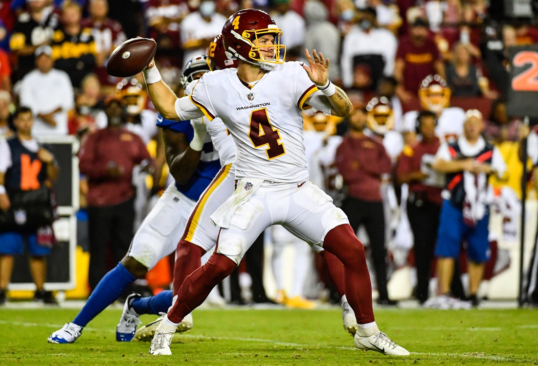 Sep 16, 2021; Landover, Maryland, USA; Washington Football Team quarterback Taylor Heinicke (4) attempts a pass against the New York Giants during the second half at FedExField. Mandatory Credit: Brad Mills-USA TODAY Sports