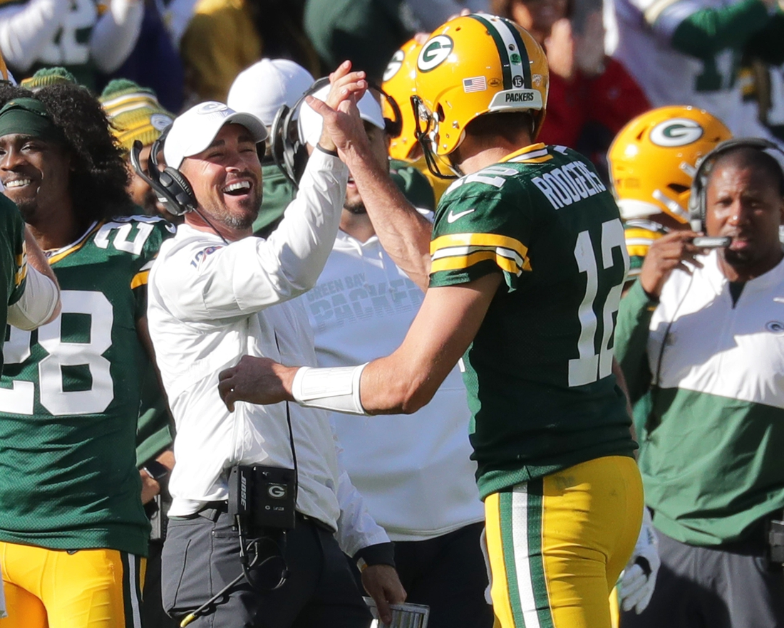 Green Bay Packers quarterback Aaron Rodgers (12) celebrates his 74 yard touchdown pass to Marquez Valdes-Scantling with Green Bay Packers head coach Matt LaFleur during the 4th quarter of the Green Bay Packers 42-24 win over the Oakland Raiders at Lambeau Field in Green Bay  on Sunday, Oct. 20, 2019.  Photo by Mike De Sisti/Milwaukee Journal Sentinel  Packers21 4373