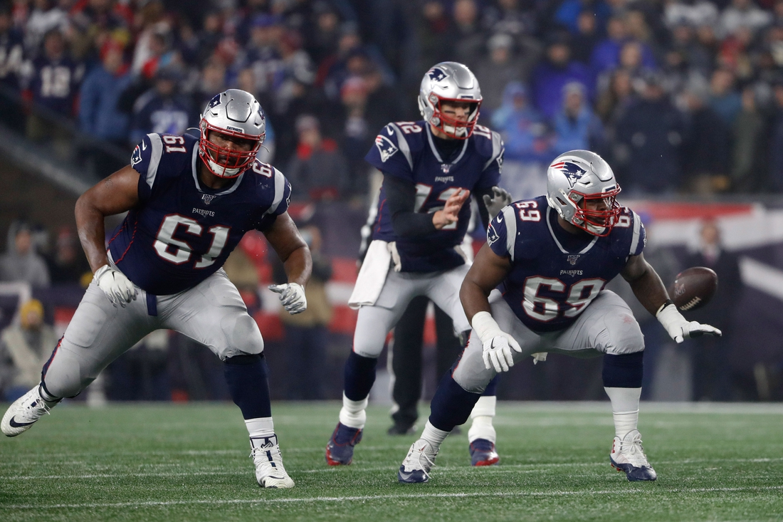 Jan 4, 2020; Foxborough, Massachusetts, USA; New England Patriots offensive tackle Marcus Cannon (61) and offensive guard Shaq Mason (69) prepare to block against the Tennessee Titans during a playoff game at Gillette Stadium. Mandatory Credit: Winslow Townson-USA TODAY Sports