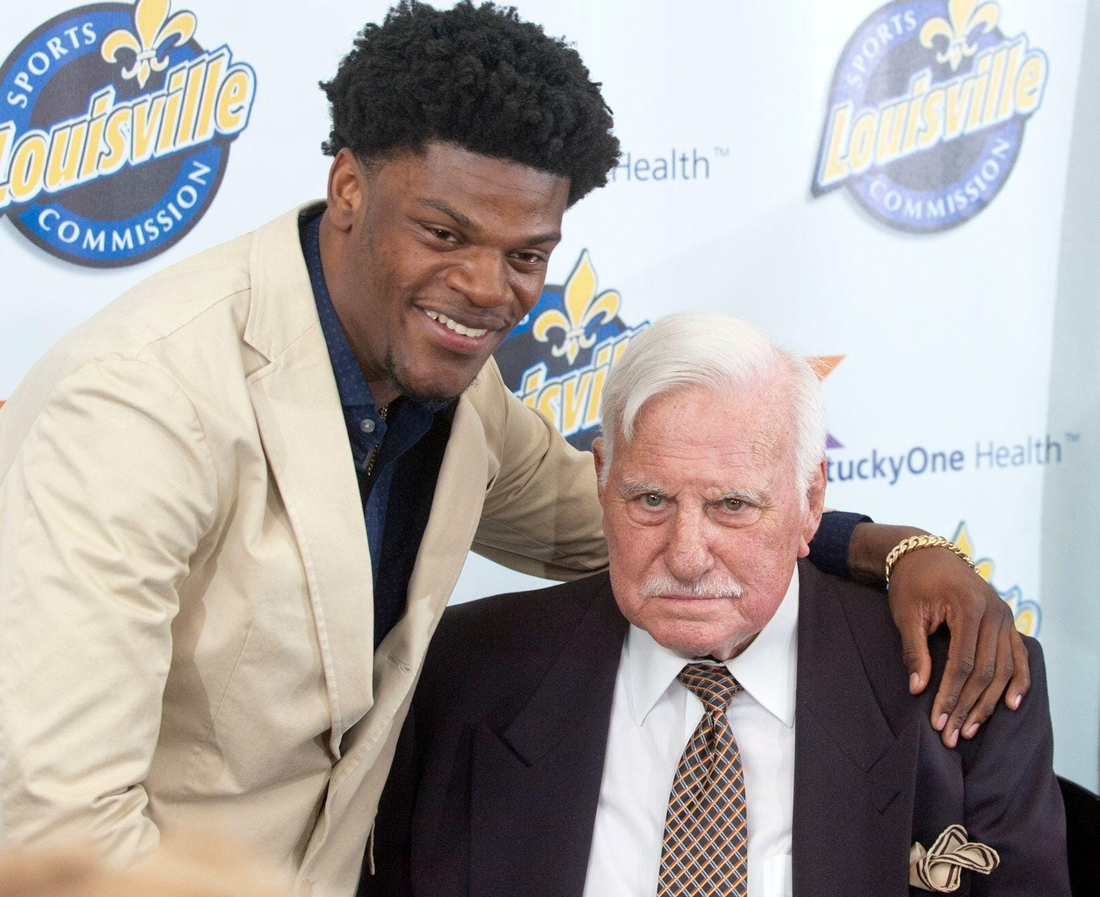 Baltimore Ravens quarterback Lamar Jackson, a former University of Louisville quarterback, puts his arm around former Cardinals head football coach Howard Schnellenberger in the VIP room of the Louisville Sports Commission's 2019 Paul Hornung Award Banquet.  ghows-LK-200608298-f26786f2.jpg