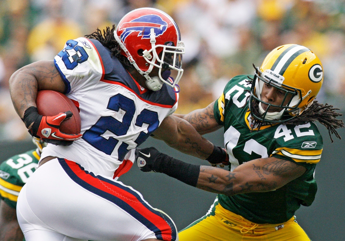 Buffalo Bills Marshawn Lynch breaks an attempted tackle by Green Bay Packers safety Morgan Burnett during the first quarter of their game Sunday, September 19, 2010 at Lambeau Field in Green Bay, Wis. The Packers won, 34-7.  Mjs Packers20 5 Of Hoffman Jpg Packers20