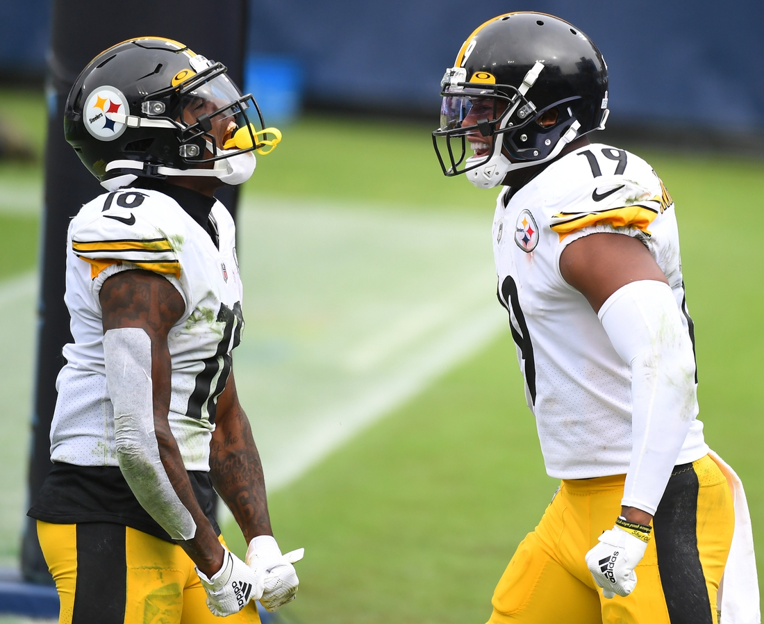 Oct 25, 2020; Nashville, Tennessee, USA; Pittsburgh Steelers wide receiver Diontae Johnson (18) and Pittsburgh Steelers wide receiver JuJu Smith-Schuster (19) celebrate after a touchdown against the Tennessee Titans at Nissan Stadium. Mandatory Credit: Christopher Hanewinckel-USA TODAY Sports