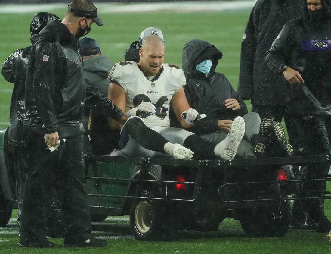 Nov 15, 2020; Foxborough, Massachusetts, USA; Baltimore Ravens tight end Nick Boyle (86) is taken off the field after suffering an injury during a play with New England Patriots linebacker Terez Hall (59) (not pictured) in the second half at Gillette Stadium. Mandatory Credit: David Butler II-USA TODAY Sports