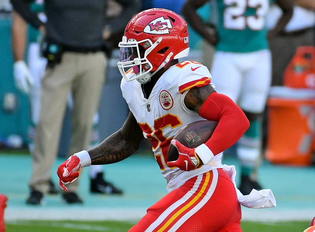 Dec 13, 2020; Miami Gardens, Florida, USA; Kansas City Chiefs running back Le'Veon Bell (26) runs the ball against the Miami Dolphins during the first half at Hard Rock Stadium. Mandatory Credit: Jasen Vinlove-USA TODAY Sports
