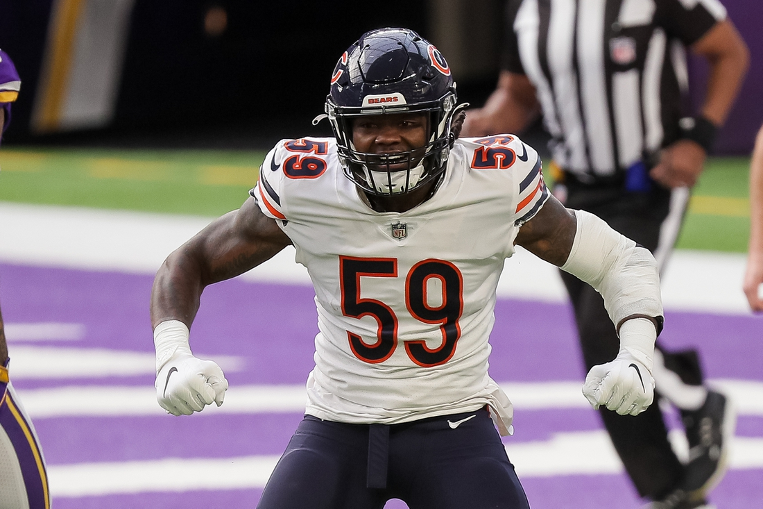 Dec 20, 2020; Minneapolis, Minnesota, USA; Chicago Bears linebacker Danny Trevathan (59) celebrates a tackle in the first quarter against the Minnesota Vikings at U.S. Bank Stadium. Mandatory Credit: Brad Rempel-USA TODAY Sports