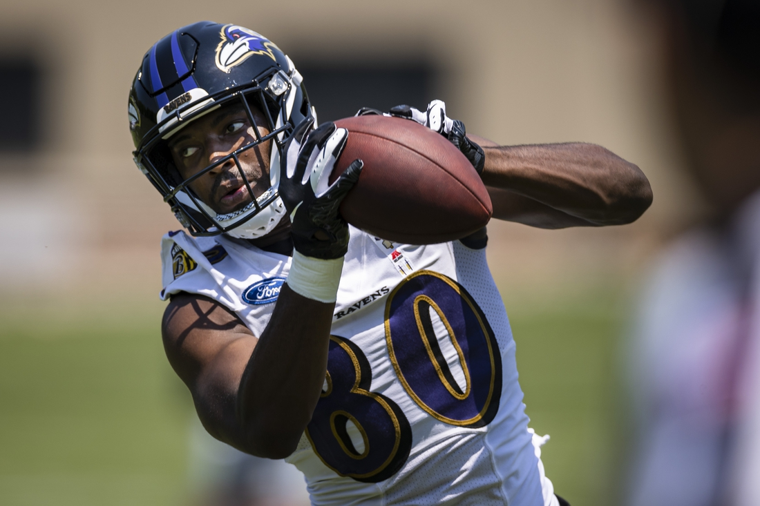 May 26, 2021; Owings Mills, Maryland, USA; Baltimore Ravens wide receiver Miles Boykin (80) catches a pass during an OTA at Under Armour Performance Center. Mandatory Credit: Scott Taetsch-USA TODAY Sports