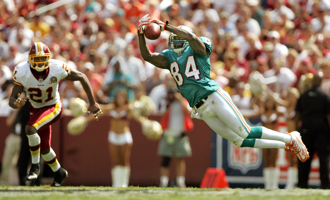 090907 sptdolphins Staff photo by Allen Eyestone/The Palm Beach Post--0042446A--Landover, MD...FedExField...Miami Dolphins at Washington Football Team. Dolphins WR #84 Chris Chambers makes a leaping catch for a first down as Redskins #21 Sean Taylor defends in the second quarter.  090907 Spt Fins Ae 18 Jpg