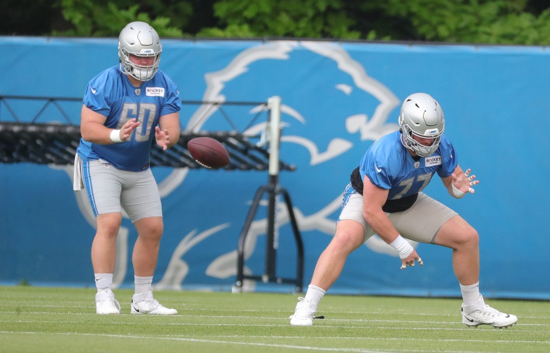 Lions centers Drake Jackson, left, and Frank Ragnow work on snaps during training camp in Allen Park on Thursday, July 29, 2021.  Lions