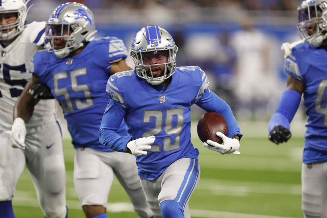 Aug 27, 2021; Detroit, Michigan, USA; Detroit Lions cornerback Corn Elder (29) runs the ball after an interception during the third quarter against the Indianapolis Colts at Ford Field. He was later ruled down by contact at the spot of the interception. Mandatory Credit: Raj Mehta-USA TODAY Sports