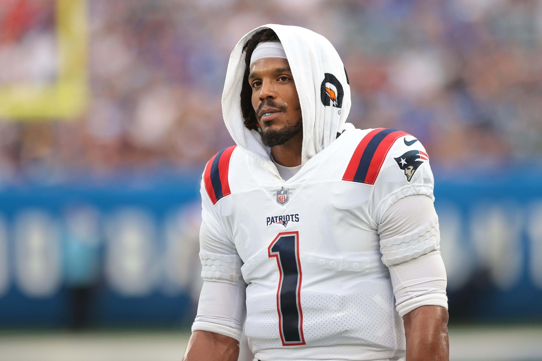 Aug 29, 2021; East Rutherford, New Jersey, USA; New England Patriots quarterback Cam Newton (1) looks on during the first half against the New York Giants at MetLife Stadium. Mandatory Credit: Vincent Carchietta-USA TODAY Sports