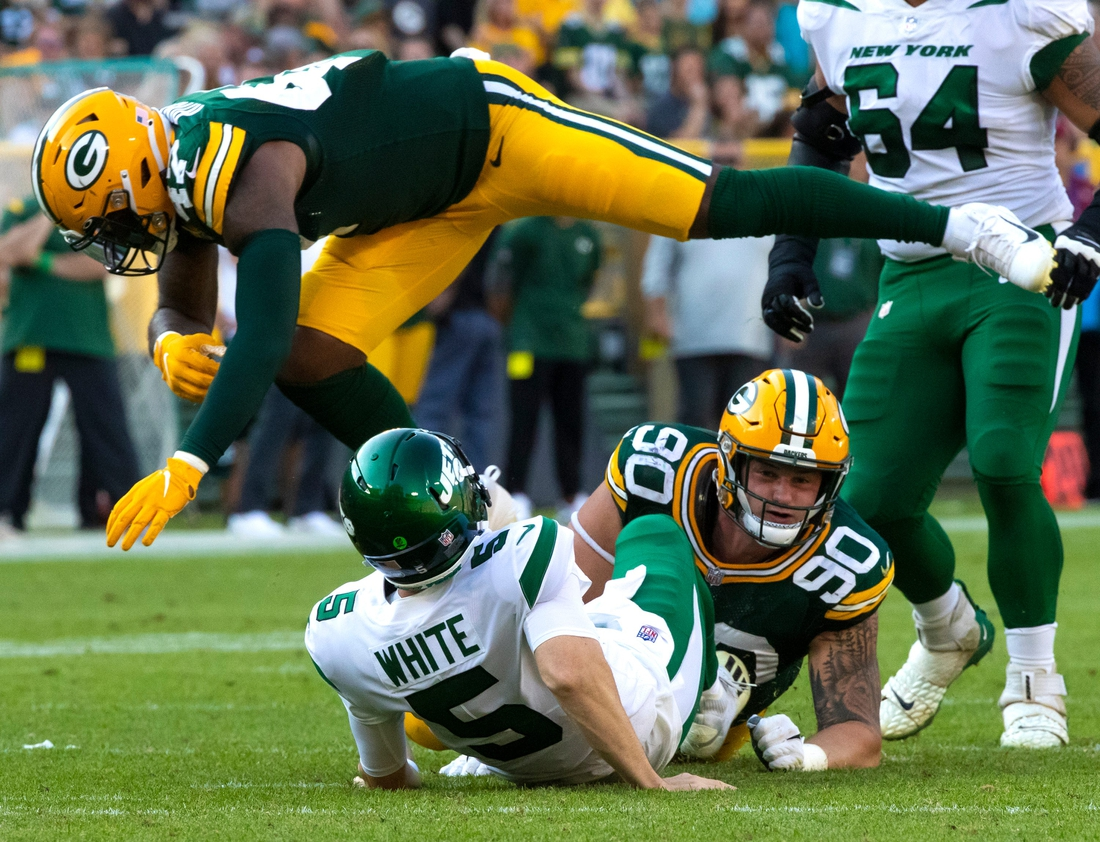 Green Bay Packers linebacker Chauncey Rivers (47) leaps over New York Jets quarterback Mike White (5) after White was tackled by Green Bay Packers' Jack Heflin (90)  in the second half during their preseason football game on Saturday, August 21, 2021, at Lambeau Field in Green Bay, Wis.  Mjs Gpg Heflin 08212021 0020