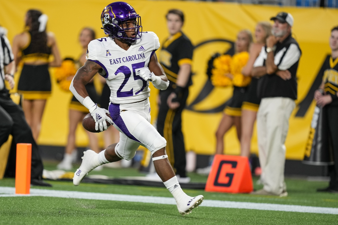 Sep 2, 2021; Charlotte, North Carolina, USA; East Carolina Pirates running back Keaton Mitchell (25) outruns the Appalachian State Mountaineers defense for a score during the first quarter at Bank of America Stadium. Mandatory Credit: Jim Dedmon-USA TODAY Sports